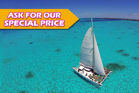 Sail to Isla Mujeres on a private catamaran.