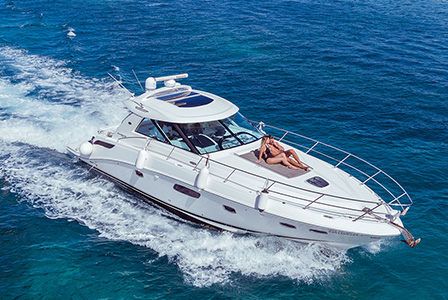 Tour the pristine waters of the Caribbean Sea and visit Isla Mujeres in a luxury yacht.