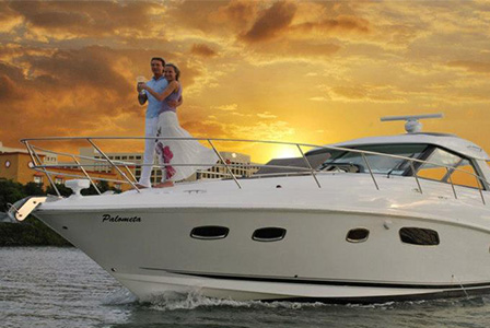 Enjoy a delicious dinner on board a luxury yacht while you sail at sunset in Cancun.